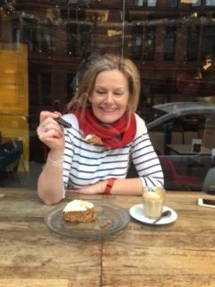 Woman in striped top eating cake