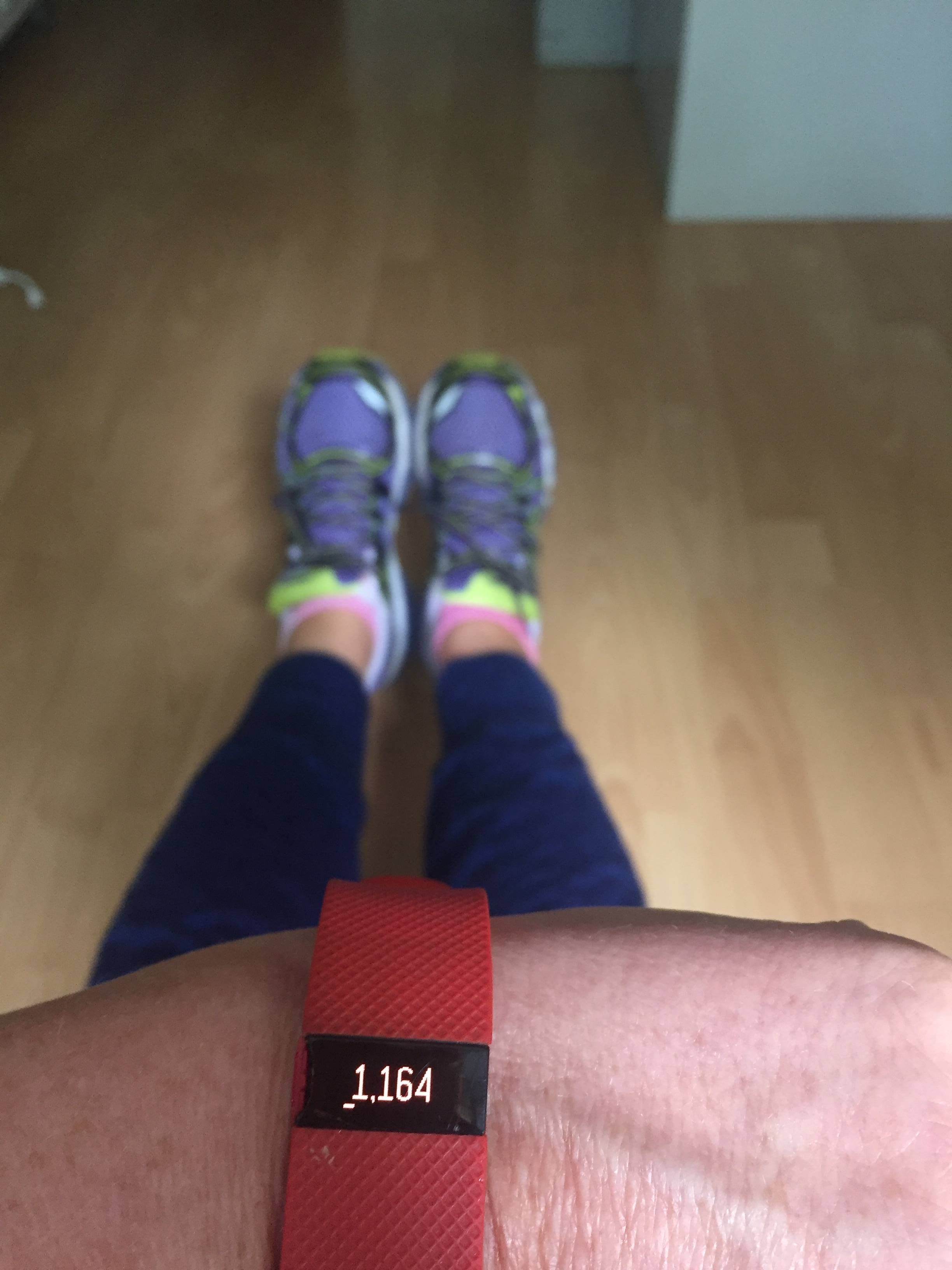 Woman with fitbit to help maintain midlife weight