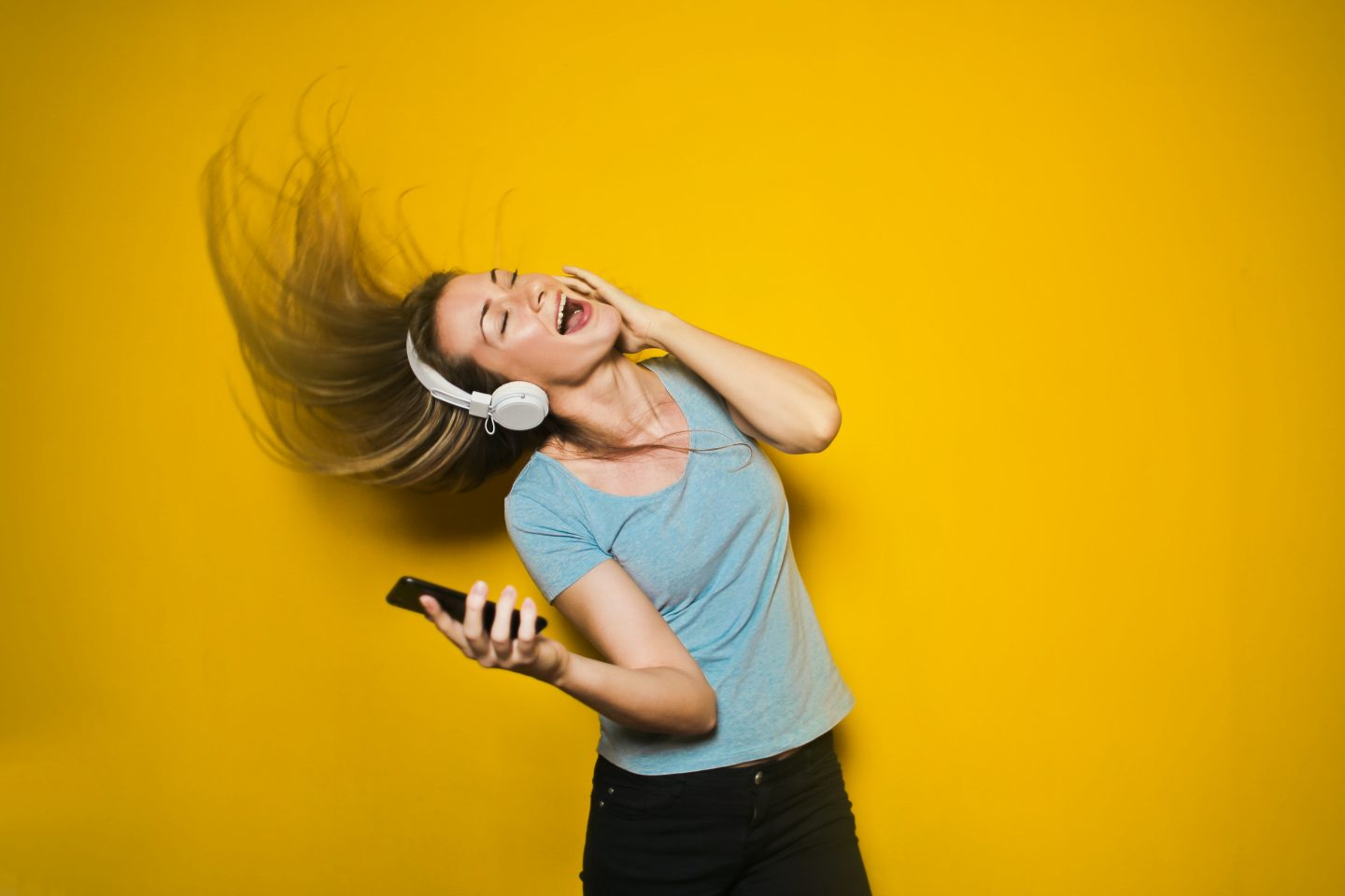 Woman having fun singing along to music