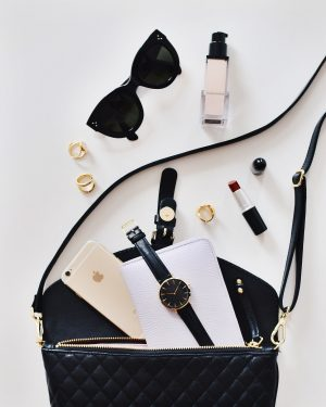 A Flat Lay showing the contents of a handbag