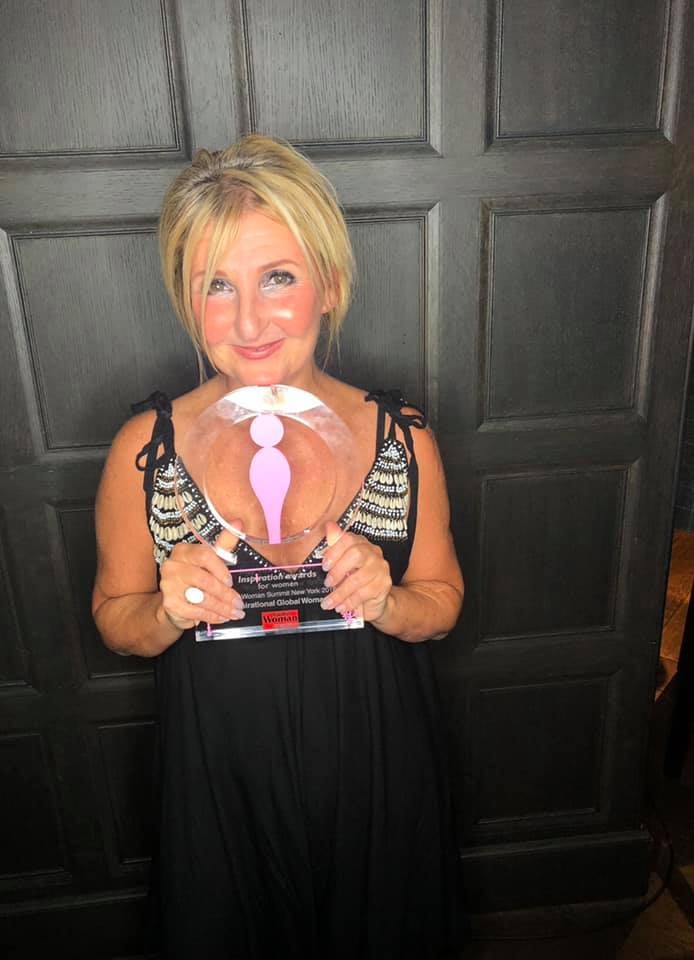 Christine, founder of The Key holds Global Woman Inspiration Award