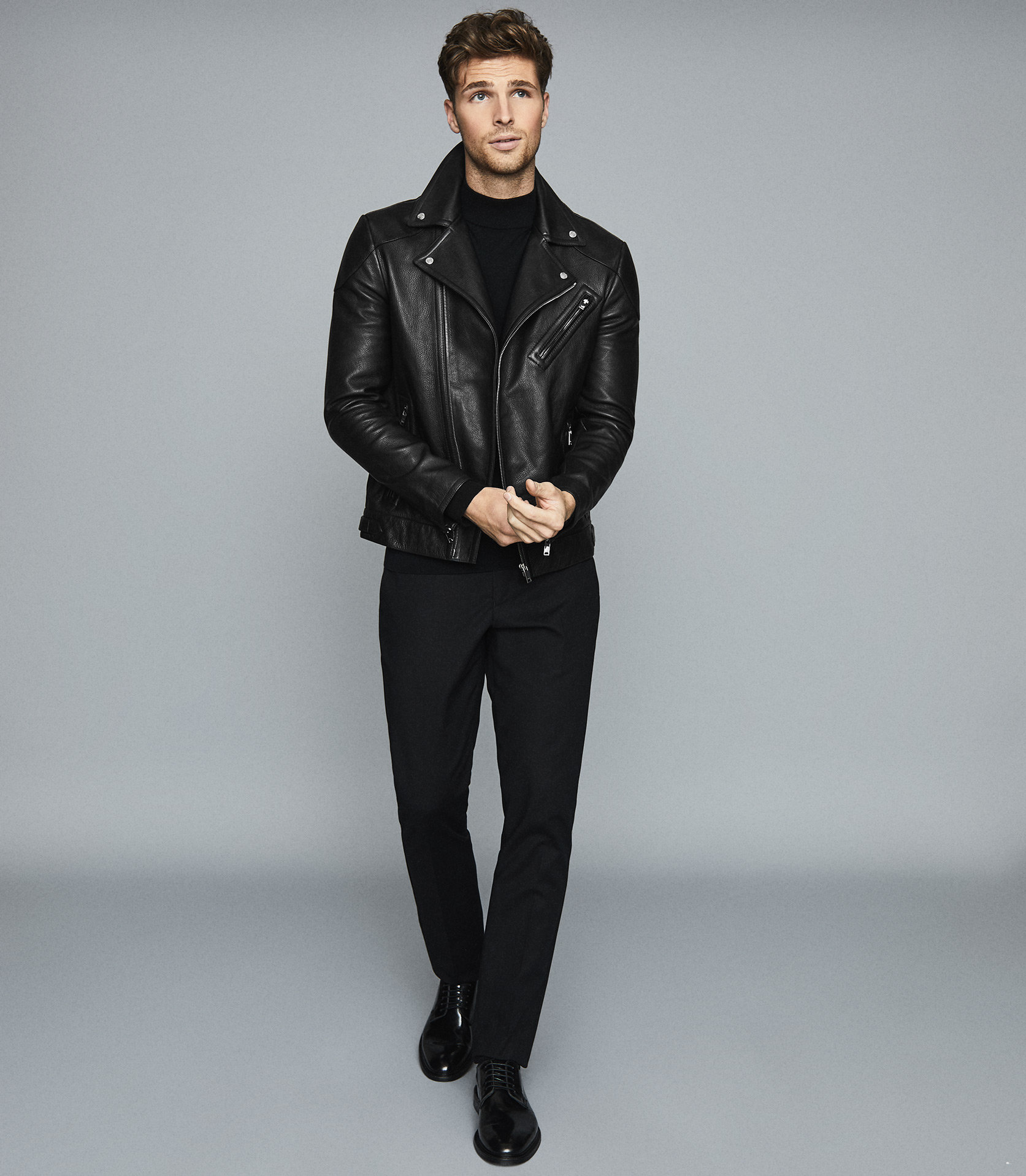 A man modelling a leather jacket - a Christmas Gifts for HIM that YOU will LOVE